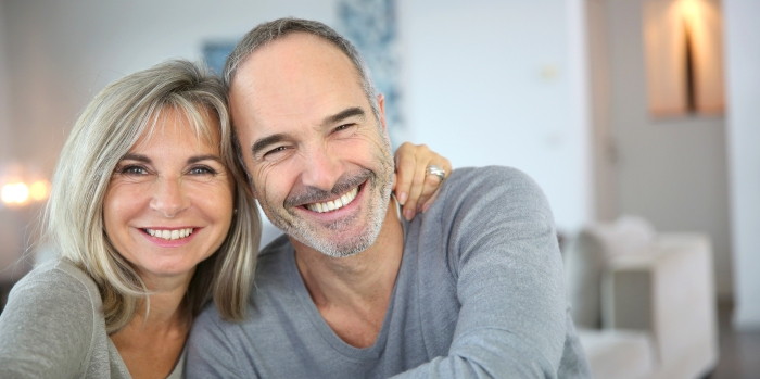 husband and wife enjoy healthy smiles